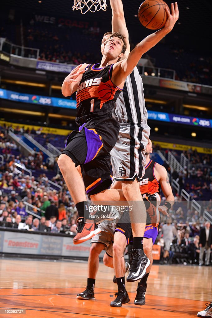 <a gi-track='captionPersonalityLinkClicked' href=/galleries/search?phrase=Goran+Dragic&family=editorial&specificpeople=4452965 ng-click='$event.stopPropagation()'>Goran Dragic</a> #1 of the Phoenix Suns drives for a shot against the San Antonio Spurs on February 24, 2013 at U.S. Airways Center in Phoenix, Arizona.