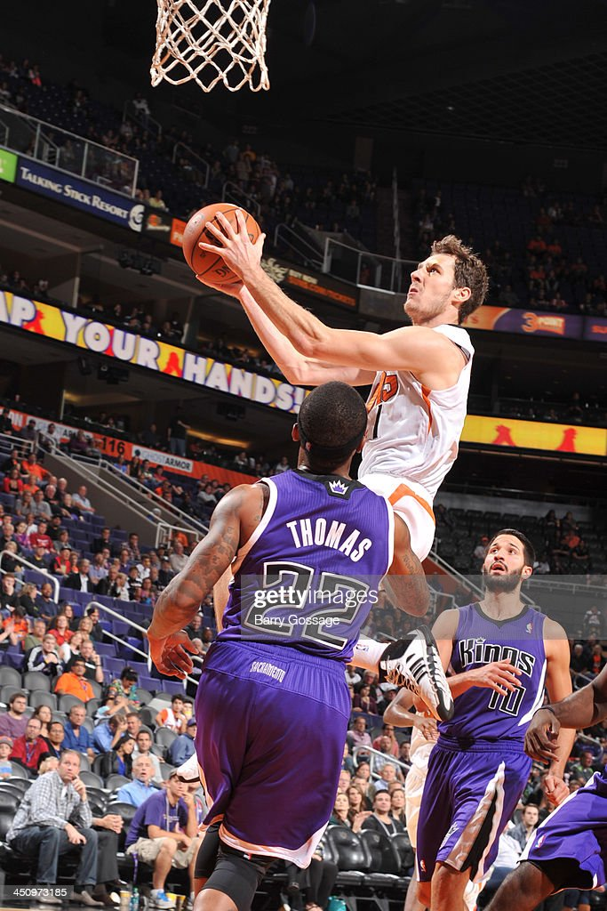 <a gi-track='captionPersonalityLinkClicked' href=/galleries/search?phrase=Goran+Dragic&family=editorial&specificpeople=4452965 ng-click='$event.stopPropagation()'>Goran Dragic</a> #1 of the Phoenix Suns drives for a shot past Isaiah Thomas #22 of the Sacramento Kings on November 20, 2013 at U.S. Airways Center in Phoenix, Arizona.