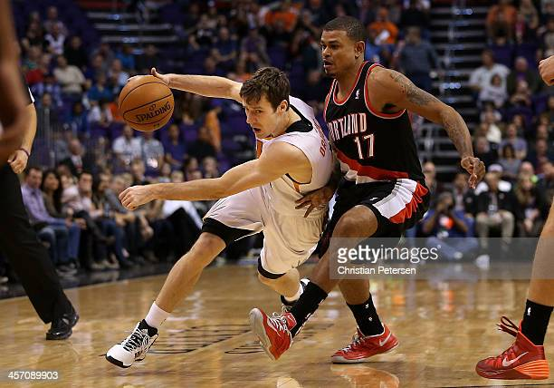 Goran Dragic of the Phoenix Suns drives the ball past Earl Watson of the Portland Trail Blazers during the NBA game at US Airways Center on November...