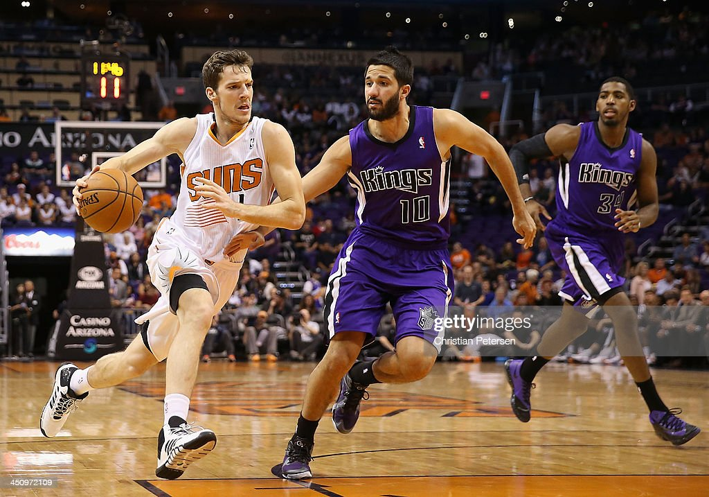 <a gi-track='captionPersonalityLinkClicked' href=/galleries/search?phrase=Goran+Dragic&family=editorial&specificpeople=4452965 ng-click='$event.stopPropagation()'>Goran Dragic</a> #1 of the Phoenix Suns drives the ball past <a gi-track='captionPersonalityLinkClicked' href=/galleries/search?phrase=Greivis+Vasquez&family=editorial&specificpeople=4066977 ng-click='$event.stopPropagation()'>Greivis Vasquez</a> #10 of the Sacramento Kings during the second half of the NBA game at US Airways Center on November 20, 2013 in Phoenix, Arizona. The Kings defeated the Suns 113-106.