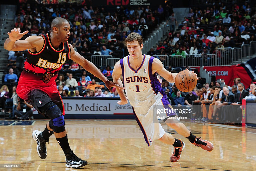 Goran Dragic #1 of the Phoenix Suns drives to the basket against Al Horford #15 of the Atlanta Hawks on March 15, 2013 at Philips Arena in Atlanta, Georgia.