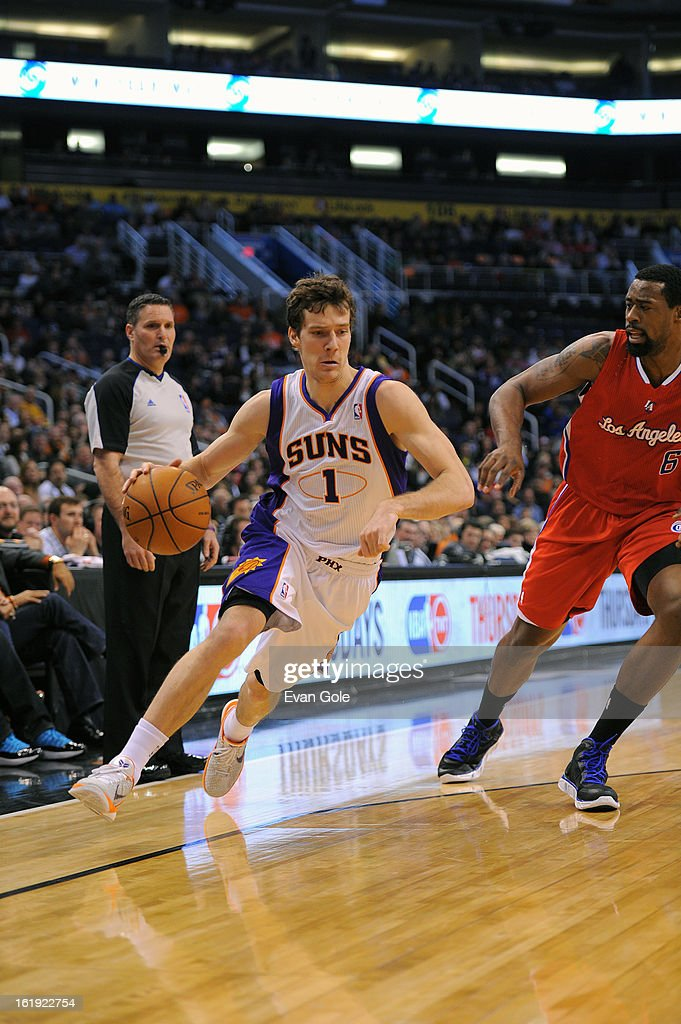 Goran Dragic #1 of the Phoenix Suns drives to the basket against DeAndre Jordan #6 of the Los Angeles Clippers at US Airways Center on January 24, 2013 in Phoenix, Arizona.