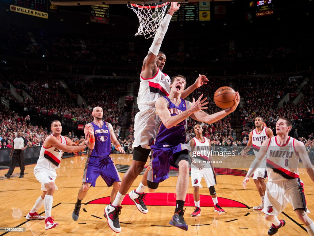 <a gi-track='captionPersonalityLinkClicked' href=/galleries/search?phrase=Goran+Dragic&family=editorial&specificpeople=4452965 ng-click='$event.stopPropagation()'>Goran Dragic</a> #1 of the Phoenix Suns drives to the basket against <a gi-track='captionPersonalityLinkClicked' href=/galleries/search?phrase=LaMarcus+Aldridge&family=editorial&specificpeople=453277 ng-click='$event.stopPropagation()'>LaMarcus Aldridge</a> #12 of the Portland Trail Blazers on December 22, 2012 at the Rose Garden Arena in Portland, Oregon.
