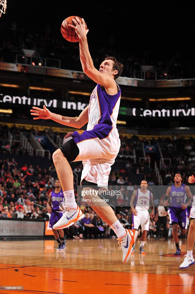 <a gi-track='captionPersonalityLinkClicked' href=/galleries/search?phrase=Goran+Dragic&family=editorial&specificpeople=4452965 ng-click='$event.stopPropagation()'>Goran Dragic</a> #1 of the Phoenix Suns drives to the basket against the Sacramento Kings on December 17, 2012 at U.S. Airways Center in Phoenix, Arizona.