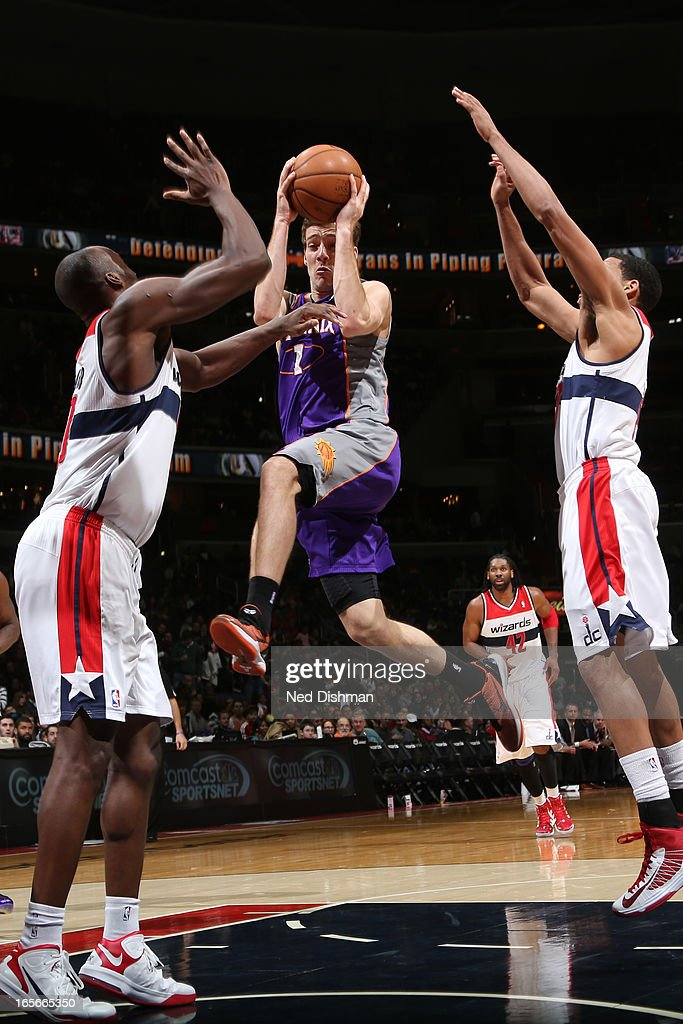 <a gi-track='captionPersonalityLinkClicked' href=/galleries/search?phrase=Goran+Dragic&family=editorial&specificpeople=4452965 ng-click='$event.stopPropagation()'>Goran Dragic</a> #1 of the Phoenix Suns drives to the basket against the Washington Wizards at the Verizon Center on March 16, 2013 in Washington, DC.
