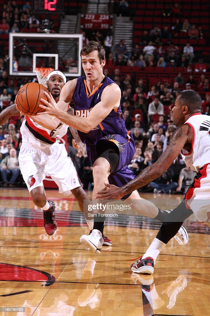 Goran Dragic #1 of the Phoenix Suns drives to the basket against the Portland Trail Blazers on October 9, 2013 at the Moda Center Arena in Portland, Oregon.