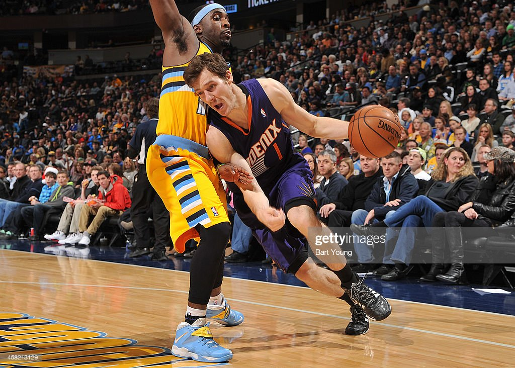 <a gi-track='captionPersonalityLinkClicked' href=/galleries/search?phrase=Goran+Dragic&family=editorial&specificpeople=4452965 ng-click='$event.stopPropagation()'>Goran Dragic</a> #1 of the Phoenix Suns drives to the basket against the Denver Nuggets on December 20, 2013 at the Pepsi Center in Denver, Colorado.