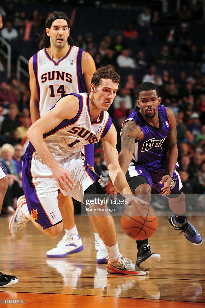 <a gi-track='captionPersonalityLinkClicked' href=/galleries/search?phrase=Goran+Dragic&family=editorial&specificpeople=4452965 ng-click='$event.stopPropagation()'>Goran Dragic</a> #1 of the Phoenix Suns drives to the basket around Aaron Brooks #3 of the Sacramento Kings on December 17, 2012 at U.S. Airways Center in Phoenix, Arizona.