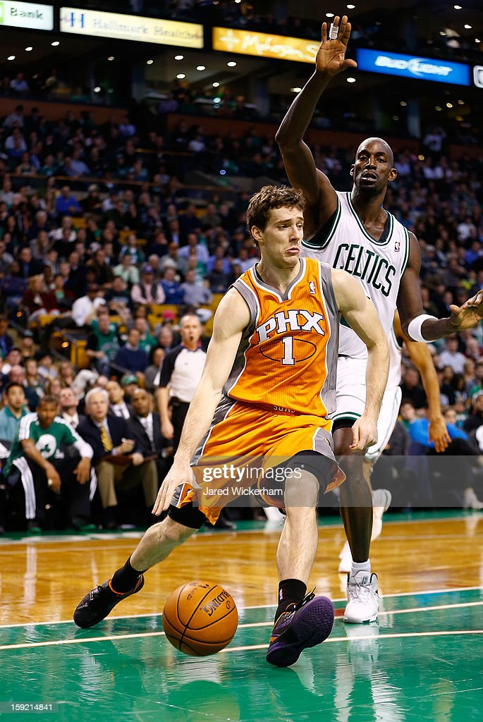 Goran Dragic #1 of the Phoenix Suns drives to the basket past Kevin Garnett #5 of the Boston Celtics during the game on January 9, 2013 at TD Garden in Boston, Massachusetts.