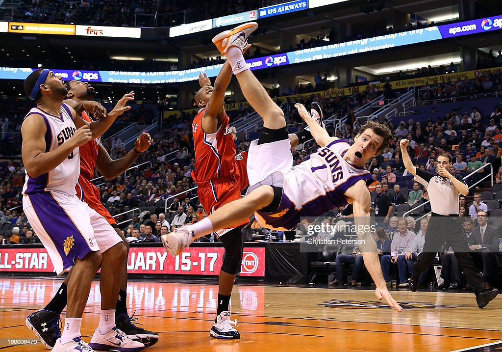 <a gi-track='captionPersonalityLinkClicked' href=/galleries/search?phrase=Goran+Dragic&family=editorial&specificpeople=4452965 ng-click='$event.stopPropagation()'>Goran Dragic</a> #1 of the Phoenix Suns falls hard to the court after being fouled by <a gi-track='captionPersonalityLinkClicked' href=/galleries/search?phrase=Caron+Butler&family=editorial&specificpeople=201744 ng-click='$event.stopPropagation()'>Caron Butler</a> #5 of the Los Angeles Clippers during the second half of the NBA game at US Airways Center on January 24, 2013 in Phoenix, Arizona. The Suns defeated the Clippers 93-88.