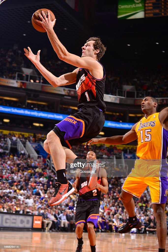 <a gi-track='captionPersonalityLinkClicked' href=/galleries/search?phrase=Goran+Dragic&family=editorial&specificpeople=4452965 ng-click='$event.stopPropagation()'>Goran Dragic</a> #1 of the Phoenix Suns glides to the basket against the Los Angeles Lakers on March 18, 2013 at U.S. Airways Center in Phoenix, Arizona.