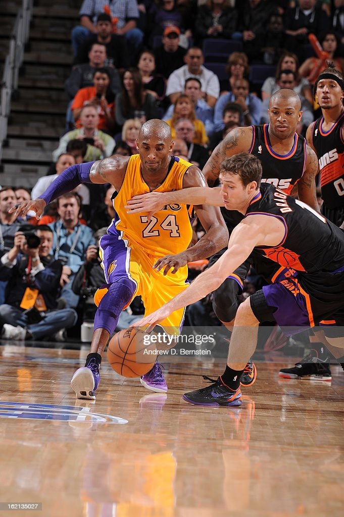 Goran Dragic #1 of the Phoenix Suns goes for a loose ball against Kobe Bryant #24 of the Los Angeles Lakers at US Airways Center on January 30, 2013 in Phoenix, Arizona.