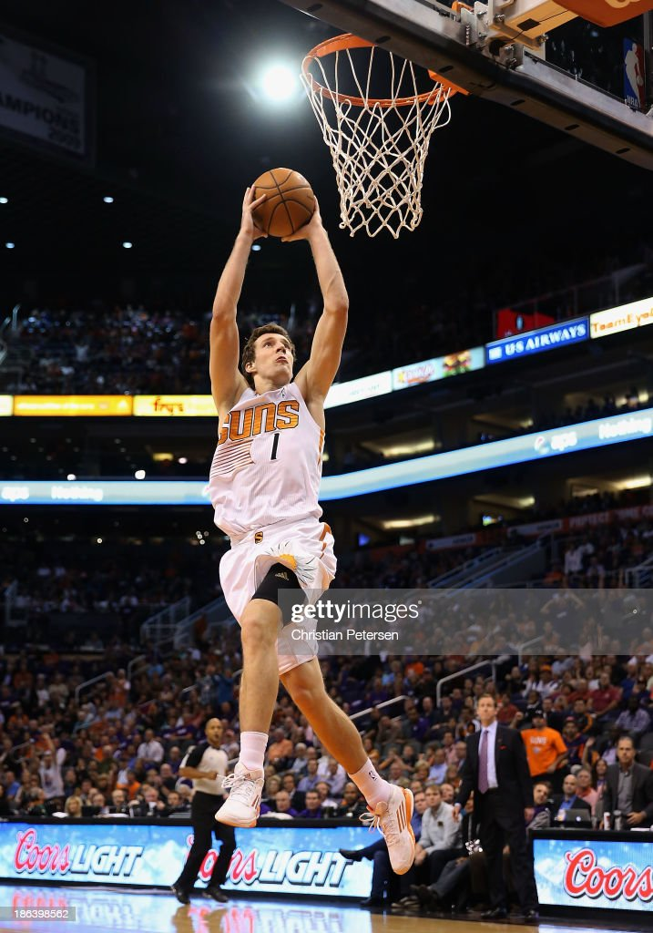 <a gi-track='captionPersonalityLinkClicked' href=/galleries/search?phrase=Goran+Dragic&family=editorial&specificpeople=4452965 ng-click='$event.stopPropagation()'>Goran Dragic</a> #1 of the Phoenix Suns goes up for a slam dunk against the Portland Trail Blazers during the opening night NBA game at US Airways Center on October 30, 2013 in Phoenix, Arizona. The Suns defeated the Trail Blazers 104-91.