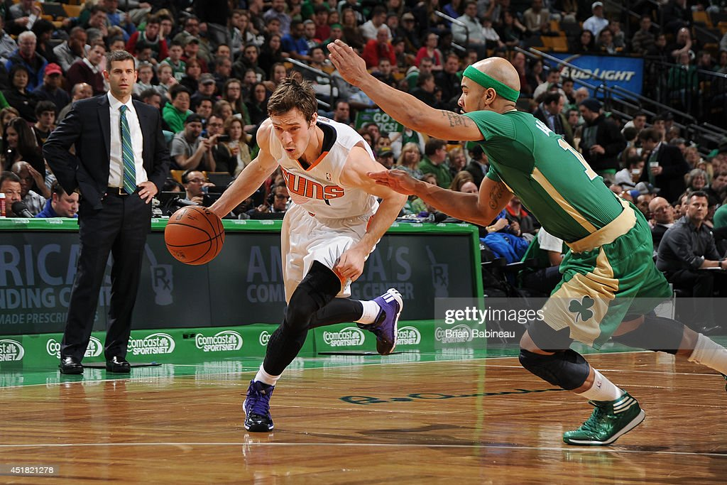 <a gi-track='captionPersonalityLinkClicked' href=/galleries/search?phrase=Goran+Dragic&family=editorial&specificpeople=4452965 ng-click='$event.stopPropagation()'>Goran Dragic</a> #1 of the Phoenix Suns handles the ball against the Boston Celtics on March 14, 2014 at the TD Garden in Boston, Massachusetts.