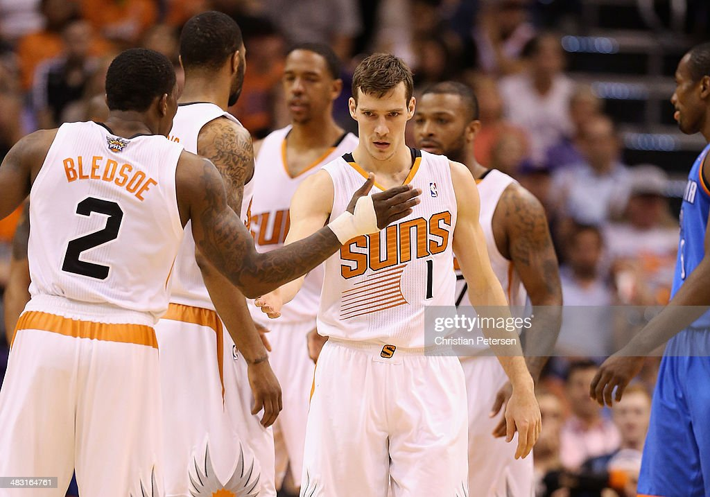 Goran Dragic #1 of the Phoenix Suns high fives Eric Bledsoe #2 after scoring and drawing a foul against the Oklahoma City Thunder during the second half of the NBA game at US Airways Center on April 6, 2014 in Phoenix, Arizona. The Suns defeated the Thunder 122-115.