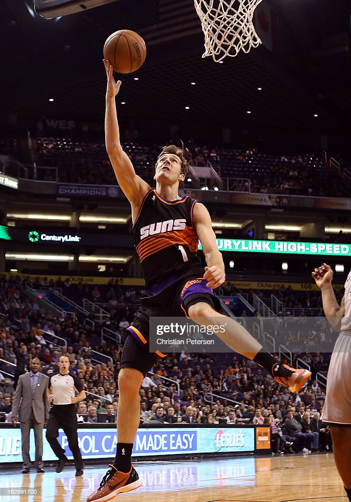 <a gi-track='captionPersonalityLinkClicked' href=/galleries/search?phrase=Goran+Dragic&family=editorial&specificpeople=4452965 ng-click='$event.stopPropagation()'>Goran Dragic</a> #1 of the Phoenix Suns lays up a shot against the San Antonio Spurs during the second half of the NBA game at US Airways Center on February 24, 2013 in Phoenix, Arizona.