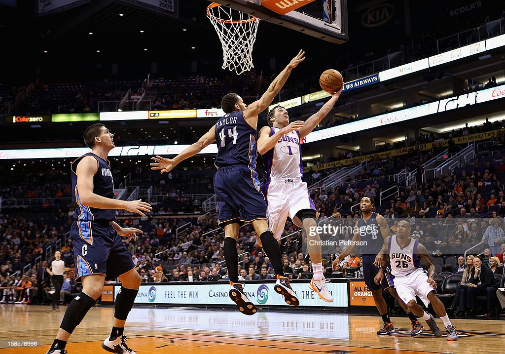 <a gi-track='captionPersonalityLinkClicked' href=/galleries/search?phrase=Goran+Dragic&family=editorial&specificpeople=4452965 ng-click='$event.stopPropagation()'>Goran Dragic</a> #1 of the Phoenix Suns lays up a shot past Jeffery Taylor #44 of the Charlotte Bobcats during the NBA game at US Airways Center on December 19, 2012 in Phoenix, Arizona. The Suns defeated the Bobcats 121-104.