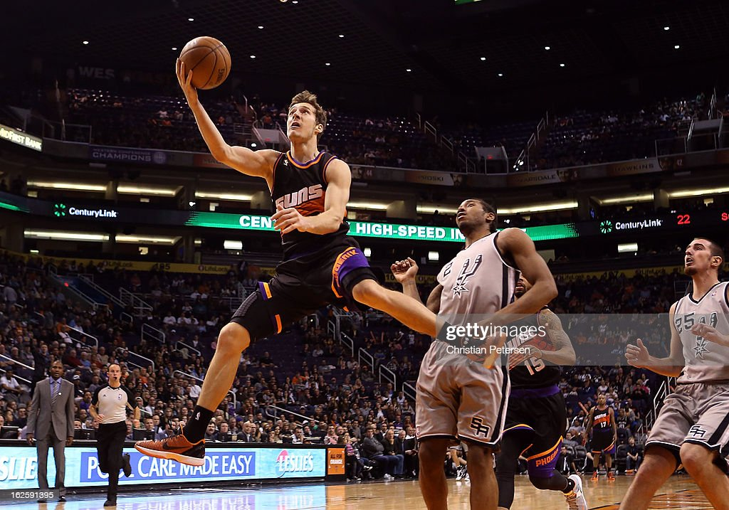 <a gi-track='captionPersonalityLinkClicked' href=/galleries/search?phrase=Goran+Dragic&family=editorial&specificpeople=4452965 ng-click='$event.stopPropagation()'>Goran Dragic</a> #1 of the Phoenix Suns lays up a shot past <a gi-track='captionPersonalityLinkClicked' href=/galleries/search?phrase=Kawhi+Leonard&family=editorial&specificpeople=6691012 ng-click='$event.stopPropagation()'>Kawhi Leonard</a> #2 of the San Antonio Spurs during the second half of the NBA game at US Airways Center on February 24, 2013 in Phoenix, Arizona.