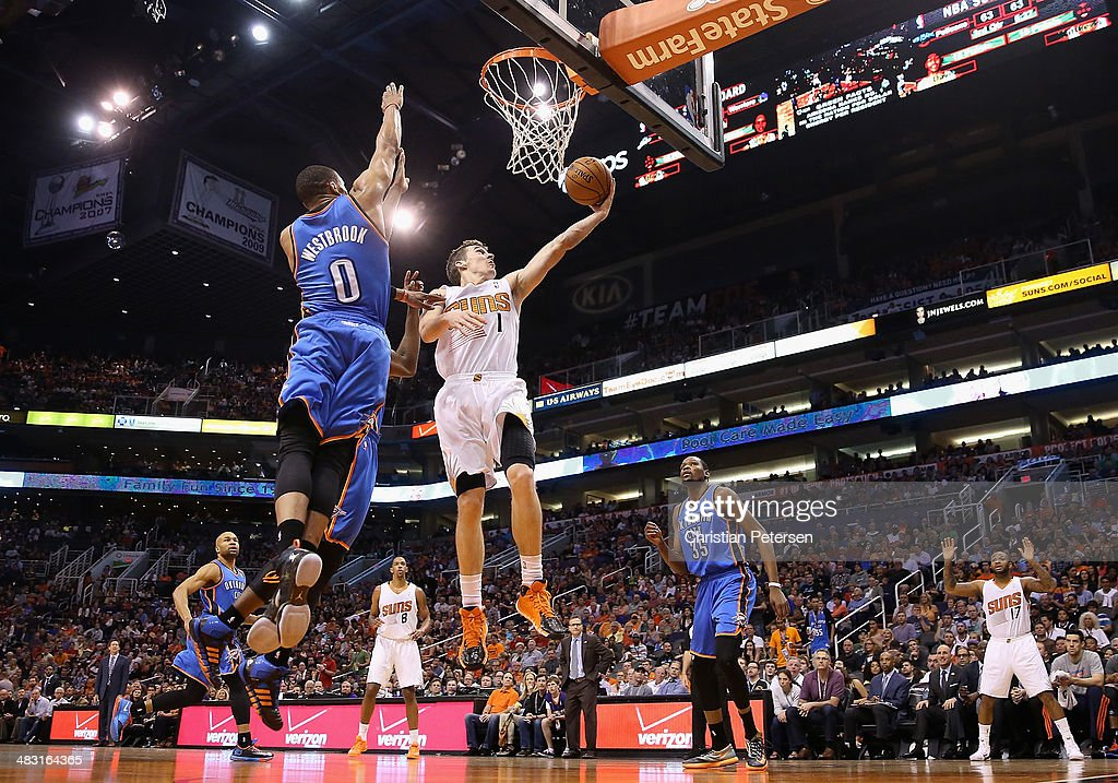 Goran Dragic of the Phoenix Suns lays up a shot past Russell Westbrook and Kevin Durant of the Oklahoma City Thunder during the second half of the...