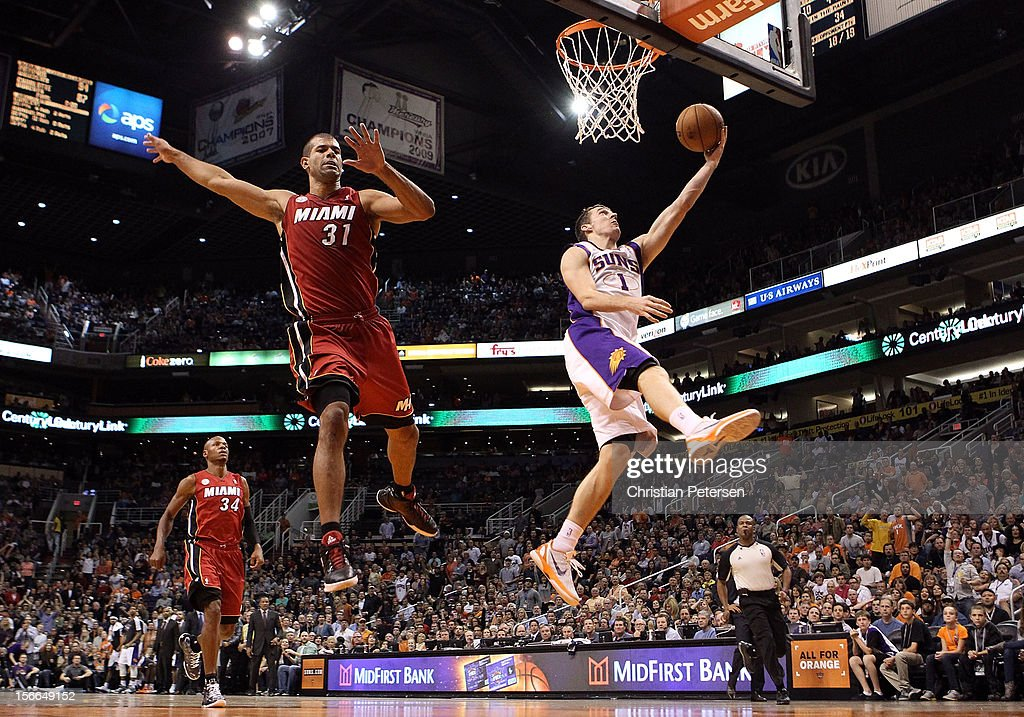 <a gi-track='captionPersonalityLinkClicked' href=/galleries/search?phrase=Goran+Dragic&family=editorial&specificpeople=4452965 ng-click='$event.stopPropagation()'>Goran Dragic</a> #1 of the Phoenix Suns lays up a shot past <a gi-track='captionPersonalityLinkClicked' href=/galleries/search?phrase=Shane+Battier&family=editorial&specificpeople=201814 ng-click='$event.stopPropagation()'>Shane Battier</a> #31 of the Miami Heat during the NBA game at US Airways Center on November 17, 2012 in Phoenix, Arizona. The Heat defeated the Suns 97-88.
