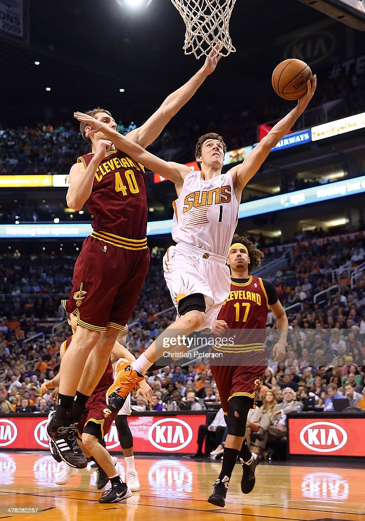 <a gi-track='captionPersonalityLinkClicked' href=/galleries/search?phrase=Goran+Dragic&family=editorial&specificpeople=4452965 ng-click='$event.stopPropagation()'>Goran Dragic</a> #1 of the Phoenix Suns lays up a shot past <a gi-track='captionPersonalityLinkClicked' href=/galleries/search?phrase=Tyler+Zeller&family=editorial&specificpeople=5122156 ng-click='$event.stopPropagation()'>Tyler Zeller</a> #40 and <a gi-track='captionPersonalityLinkClicked' href=/galleries/search?phrase=Anderson+Varejao&family=editorial&specificpeople=202247 ng-click='$event.stopPropagation()'>Anderson Varejao</a> #17 of the Cleveland Cavaliers during the second half of the NBA game at US Airways Center on March 12, 2014 in Phoenix, Arizona. The Cavaliers defeated the Suns 110-101.