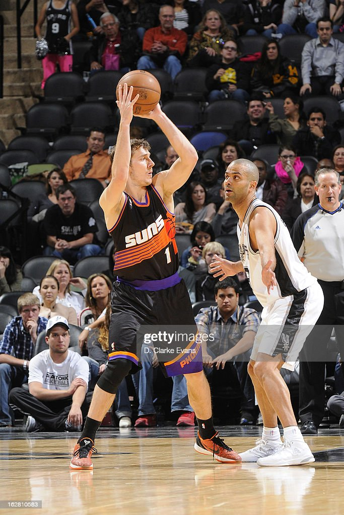 <a gi-track='captionPersonalityLinkClicked' href=/galleries/search?phrase=Goran+Dragic&family=editorial&specificpeople=4452965 ng-click='$event.stopPropagation()'>Goran Dragic</a> #1 of the Phoenix Suns looks to pass the ball against Tony Parker #9 of the San Antonio Spurs on February 27, 2013 at the AT&T Center in San Antonio, Texas.