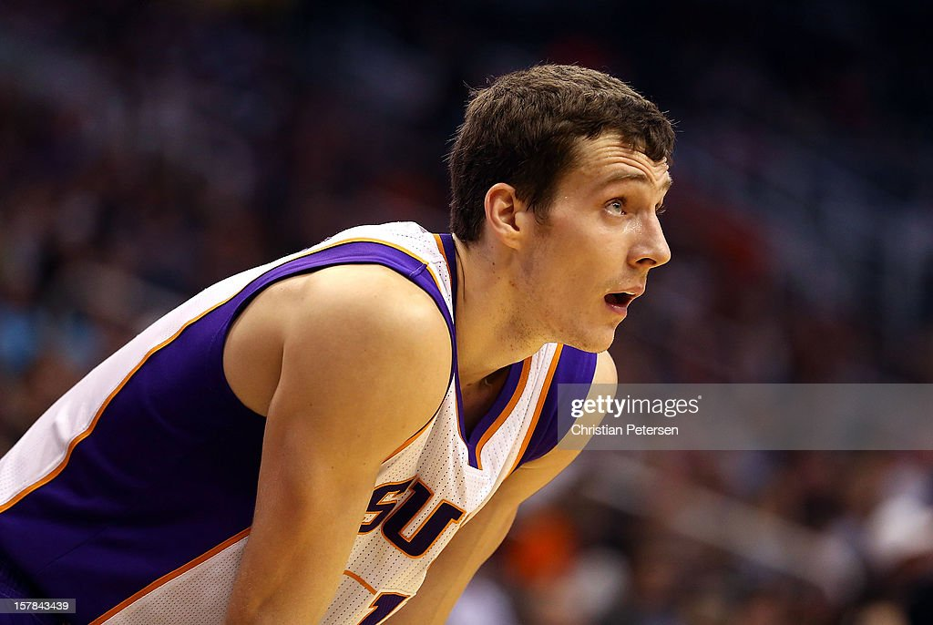 <a gi-track='captionPersonalityLinkClicked' href=/galleries/search?phrase=Goran+Dragic&family=editorial&specificpeople=4452965 ng-click='$event.stopPropagation()'>Goran Dragic</a> #1 of the Phoenix Suns looks up to the clock during the NBA game against the Dallas Mavericks at US Airways Center on December 6, 2012 in Phoenix, Arizona. The Mavericks defeated the Suns 97-94.