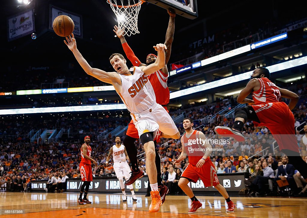 <a gi-track='captionPersonalityLinkClicked' href=/galleries/search?phrase=Goran+Dragic&family=editorial&specificpeople=4452965 ng-click='$event.stopPropagation()'>Goran Dragic</a> #1 of the Phoenix Suns makes a leaping pass ahead of <a gi-track='captionPersonalityLinkClicked' href=/galleries/search?phrase=Josh+Smith+-+Basketball+Player+-+Born+1985&family=editorial&specificpeople=201983 ng-click='$event.stopPropagation()'>Josh Smith</a> #5 of the Houston Rockets during the second half of the NBA game at US Airways Center on February 10, 2015 in Phoenix, Arizona.