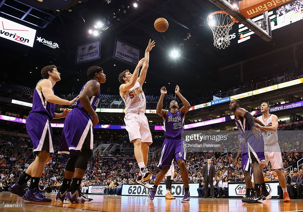 <a gi-track='captionPersonalityLinkClicked' href=/galleries/search?phrase=Goran+Dragic&family=editorial&specificpeople=4452965 ng-click='$event.stopPropagation()'>Goran Dragic</a> #1 of the Phoenix Suns puts up a shot over <a gi-track='captionPersonalityLinkClicked' href=/galleries/search?phrase=Travis+Outlaw&family=editorial&specificpeople=203322 ng-click='$event.stopPropagation()'>Travis Outlaw</a> #25 of the Sacramento Kings during the second half of the NBA game at US Airways Center on November 20, 2013 in Phoenix, Arizona. The Kings defeated the Suns 113-106.