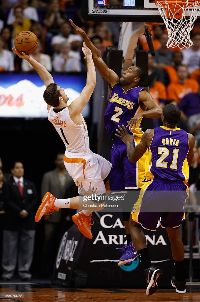 Goran Dragic of the Phoenix Suns puts up a shot over Wayne Ellington of the Los Angeles Lakers during the first half of the NBA game at US Airways...
