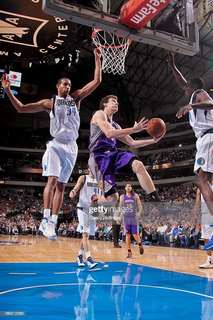 Goran Dragic #1 of the Phoenix Suns shoots a layup against Brandan Wright #34 of the Dallas Mavericks on January 27, 2013 at the American Airlines Center in Dallas, Texas.