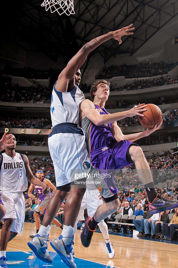 <a gi-track='captionPersonalityLinkClicked' href=/galleries/search?phrase=Goran+Dragic&family=editorial&specificpeople=4452965 ng-click='$event.stopPropagation()'>Goran Dragic</a> #1 of the Phoenix Suns shoots a layup against <a gi-track='captionPersonalityLinkClicked' href=/galleries/search?phrase=Elton+Brand&family=editorial&specificpeople=201501 ng-click='$event.stopPropagation()'>Elton Brand</a> #42 of the Dallas Mavericks on January 27, 2013 at the American Airlines Center in Dallas, Texas.