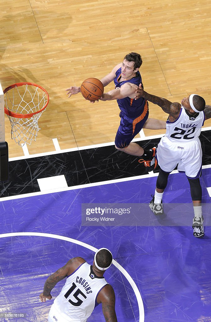 <a gi-track='captionPersonalityLinkClicked' href=/galleries/search?phrase=Goran+Dragic&family=editorial&specificpeople=4452965 ng-click='$event.stopPropagation()'>Goran Dragic</a> #1 of the Phoenix Suns shoots a layup against Isaiah Thomas #22 of the Sacramento Kings on October 17, 2013 at Sleep Train Arena in Sacramento, California.
