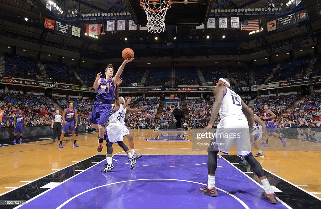 Goran Dragic #1 of the Phoenix Suns shoots a layup against Isaiah Thomas #22 of the Sacramento Kings on October 17, 2013 at Sleep Train Arena in Sacramento, California.