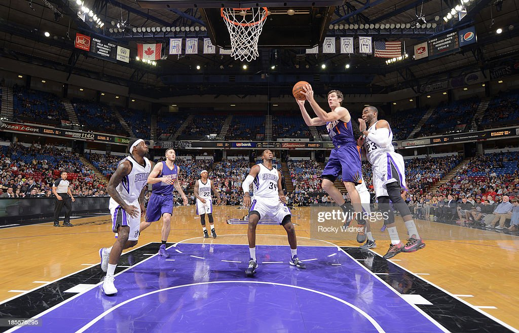 <a gi-track='captionPersonalityLinkClicked' href=/galleries/search?phrase=Goran+Dragic&family=editorial&specificpeople=4452965 ng-click='$event.stopPropagation()'>Goran Dragic</a> #1 of the Phoenix Suns shoots a layup against <a gi-track='captionPersonalityLinkClicked' href=/galleries/search?phrase=Marcus+Thornton+-+Basketball+Player+Born+1987&family=editorial&specificpeople=4679329 ng-click='$event.stopPropagation()'>Marcus Thornton</a> #23 of the Sacramento Kings on October 17, 2013 at Sleep Train Arena in Sacramento, California.