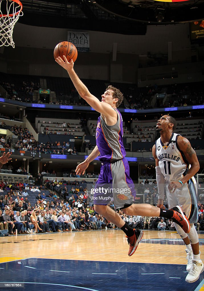Goran Dragic #1 of the Phoenix Suns shoots a layup against Mike Conley #11 of the Memphis Grizzlies on February 5, 2013 at FedExForum in Memphis, Tennessee.