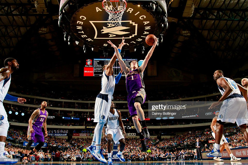 <a gi-track='captionPersonalityLinkClicked' href=/galleries/search?phrase=Goran+Dragic&family=editorial&specificpeople=4452965 ng-click='$event.stopPropagation()'>Goran Dragic</a> #1 of the Phoenix Suns shoots a layup against <a gi-track='captionPersonalityLinkClicked' href=/galleries/search?phrase=Shawn+Marion&family=editorial&specificpeople=201566 ng-click='$event.stopPropagation()'>Shawn Marion</a> #0 of the Dallas Mavericks on January 27, 2013 at the American Airlines Center in Dallas, Texas.