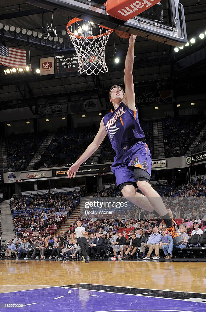 Goran Dragic #1 of the Phoenix Suns shoots a layup against the Sacramento Kings on October 17, 2013 at Sleep Train Arena in Sacramento, California.