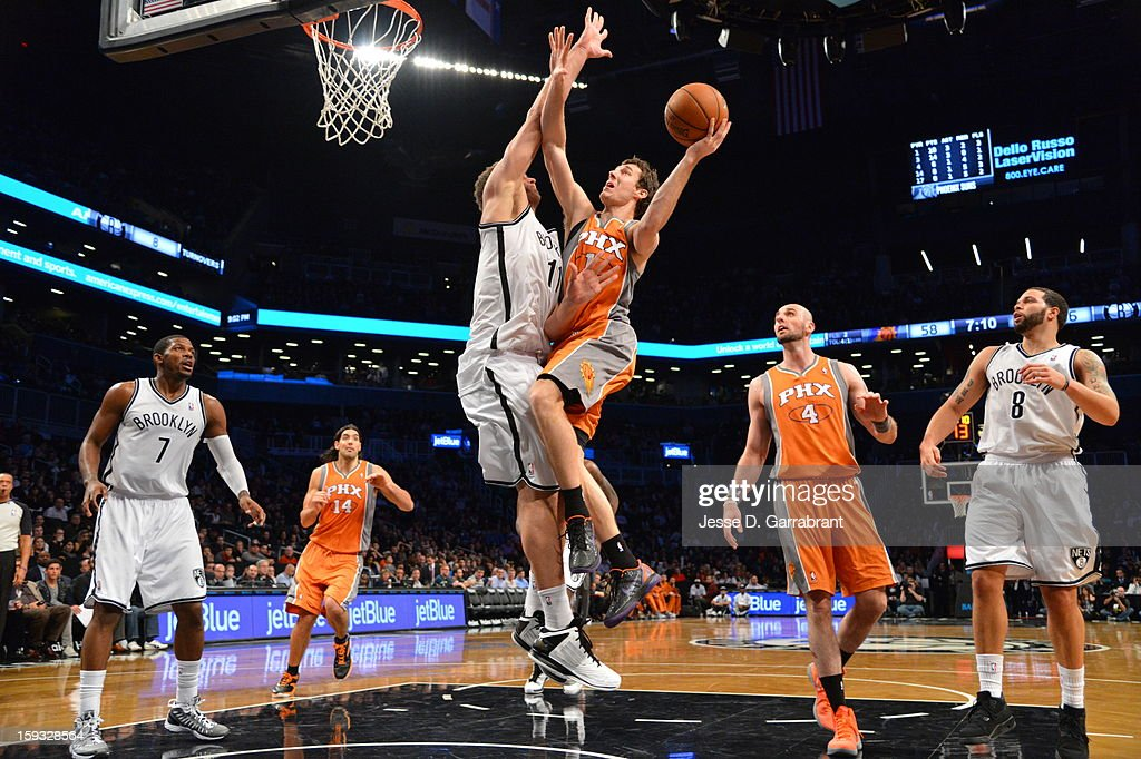 Goran Dragic #1 of the Phoenix Suns shoots against Brook Lopez #11 of the Brooklyn Nets during the game at the Barclays Center on January 11, 2013 in Brooklyn, New York.