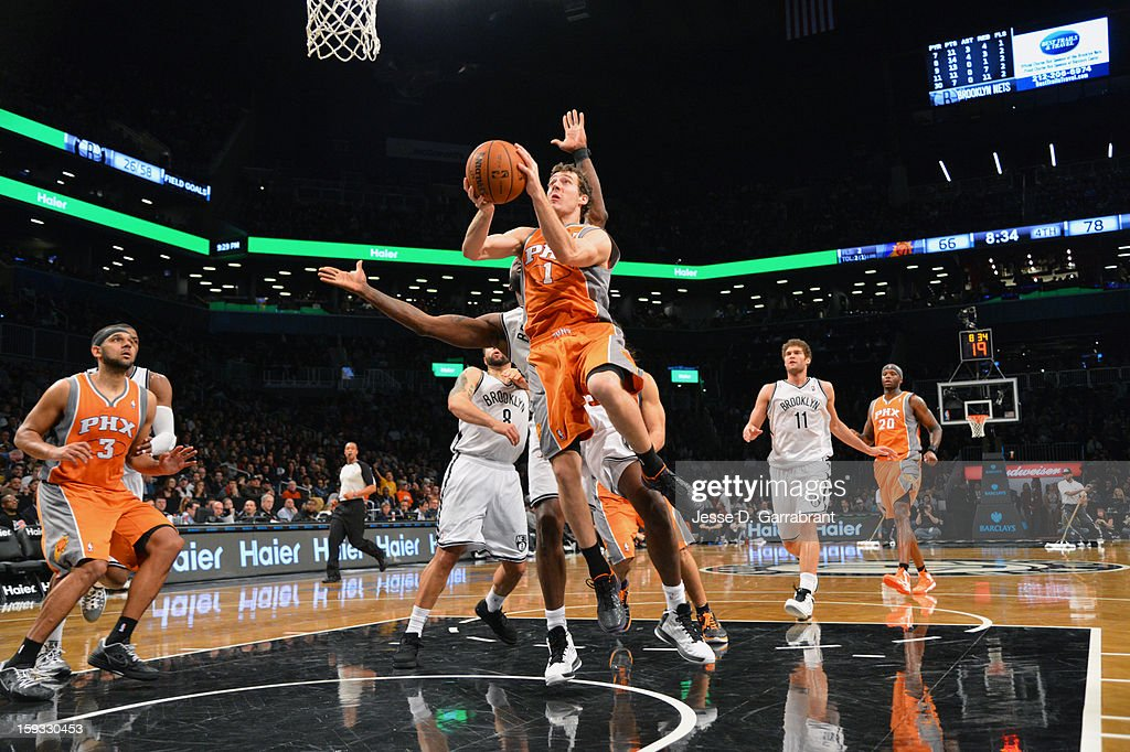 Goran Dragic #1 of the Phoenix Suns shoots against the Brooklyn Nets during the game at the Barclays Center on January 11, 2013 in Brooklyn, New York.