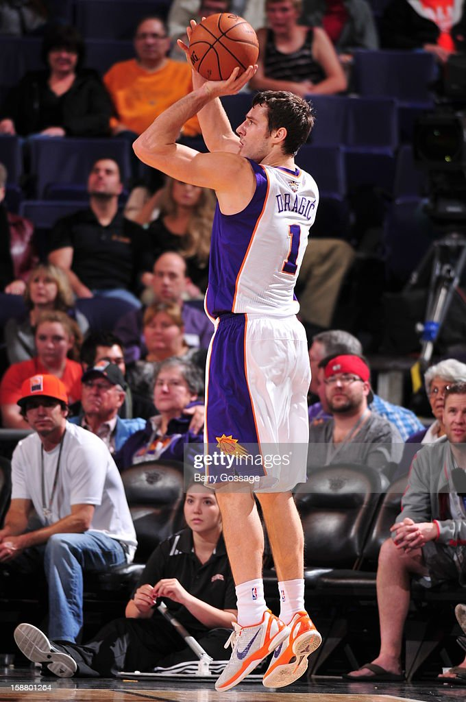 <a gi-track='captionPersonalityLinkClicked' href=/galleries/search?phrase=Goran+Dragic&family=editorial&specificpeople=4452965 ng-click='$event.stopPropagation()'>Goran Dragic</a> #1 of the Phoenix Suns shoots against the Charlotte Bobcats on December 19, 2012 at U.S. Airways Center in Phoenix, Arizona.