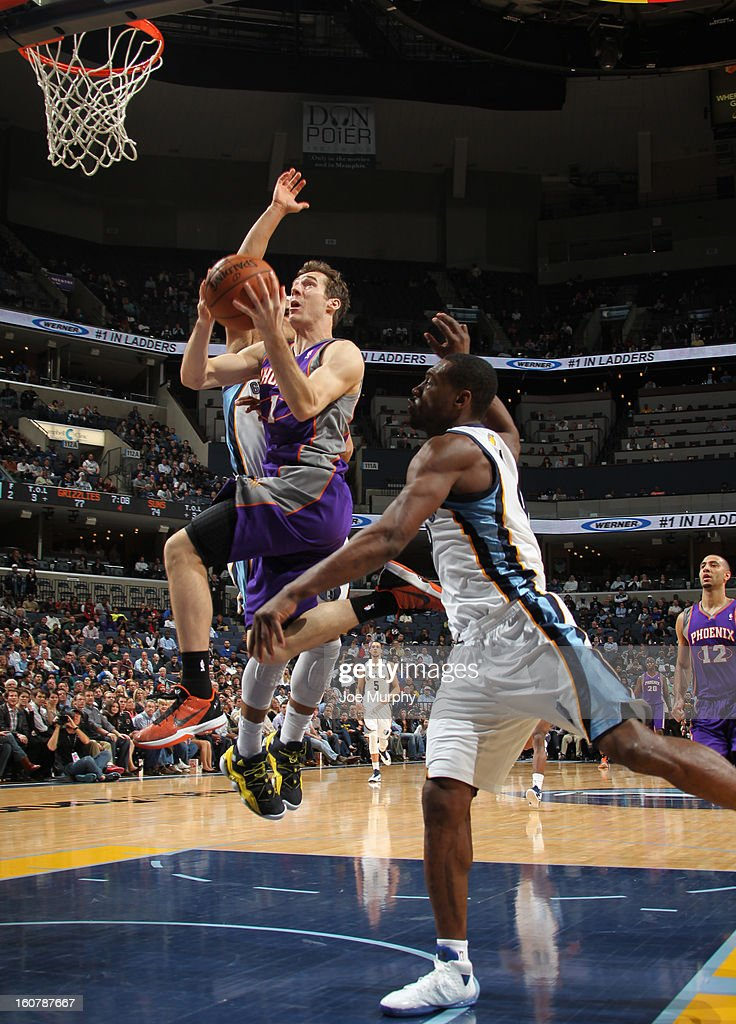 Goran Dragic #1 of the Phoenix Suns shoots against Tony Allen #9 of the Memphis Grizzlies on February 5, 2013 at FedExForum in Memphis, Tennessee.