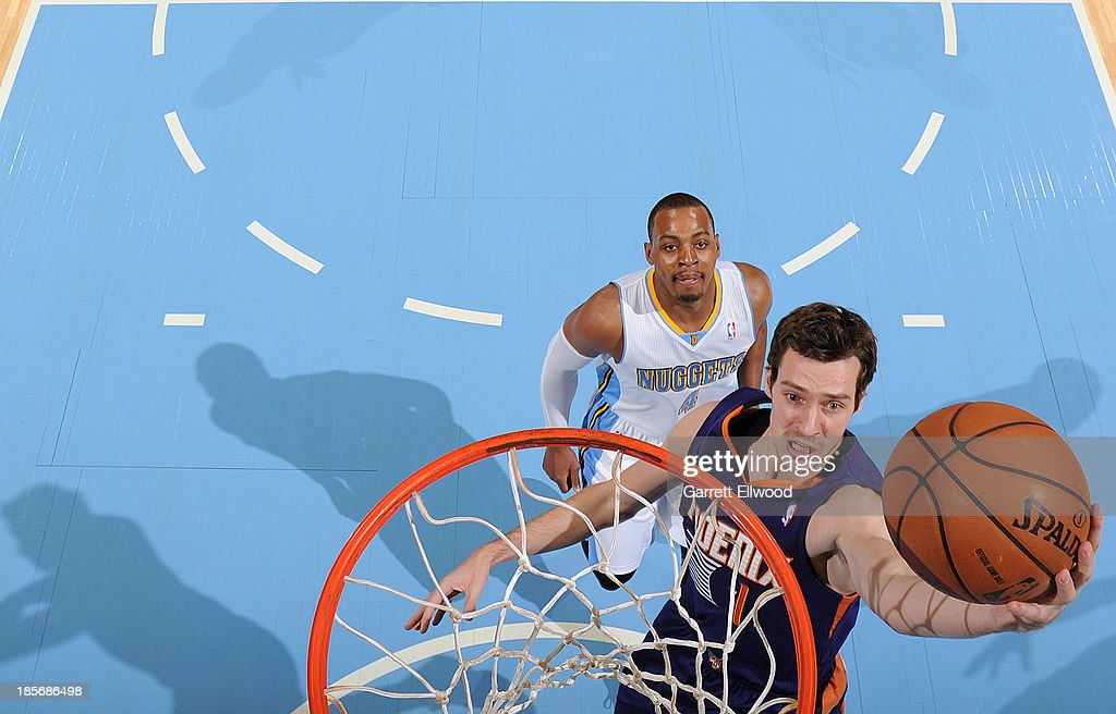 Goran Dragic #1 of the Phoenix Suns shoots the ball against Randy Foye #4 of the Denver Nuggets on October 23, 2013 at the Pepsi Center in Denver, Colorado.