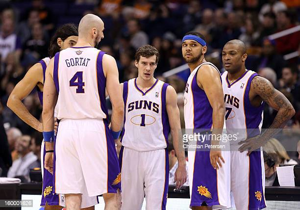 Goran Dragic of the Phoenix Suns stands with teammates Luis Scola Marcin Gortat Jared Dudley and PJ Tucker during the NBA game at US Airways Center...