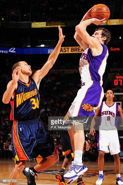 Goran Dragic of the Phoenix Suns takes a jump shot against Stephen Curry of the Golden State Warriors during the game on January 23 2010 at US...