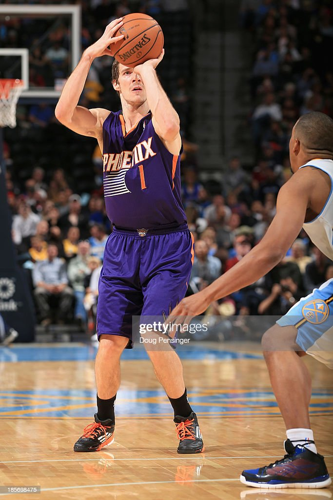 <a gi-track='captionPersonalityLinkClicked' href=/galleries/search?phrase=Goran+Dragic&family=editorial&specificpeople=4452965 ng-click='$event.stopPropagation()'>Goran Dragic</a> #1 of the Phoenix Suns takes a shot against the Denver Nuggets during preseason action at Pepsi Center on October 23, 2013 in Denver, Colorado. The Suns defeated the Nuggets 98-79.