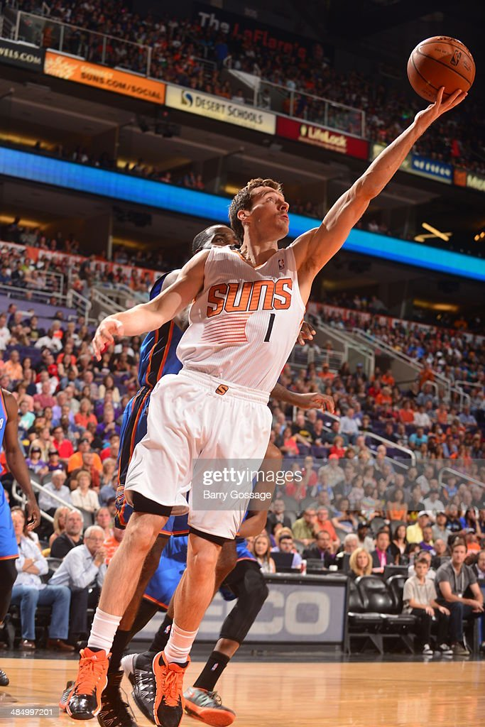 Goran Dragic #1 of the Phoenix Suns takes a shot against the Oklahoma City Thunder on April 6, 2014 at U.S. Airways Center in Phoenix, Arizona.