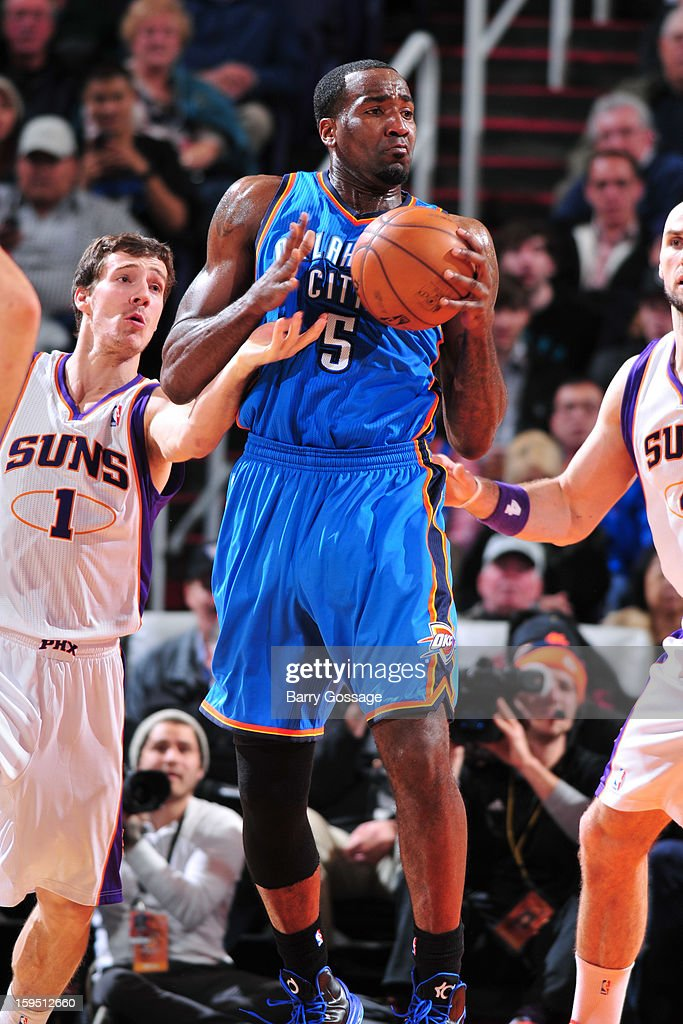 Goran Dragic #1 of the Phoenix Suns tries to steal the ball from Kendrick Perkins #5 of the Oklahoma City Thunder on January 14, 2013 at U.S. Airways Center in Phoenix, Arizona.