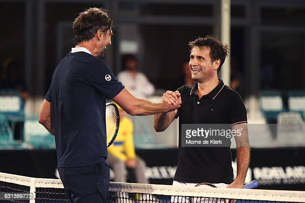 Goran Ivanisevic of Croatia and Fabrice Santoro of France shake hands after they played against each other during day one of the 2017 World Tennis...