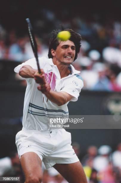Goran Ivanisevic of Croatia makes a double backhand return against Pete Sampras during their Men's Singles Final match at the Wimbledon Lawn Tennis...
